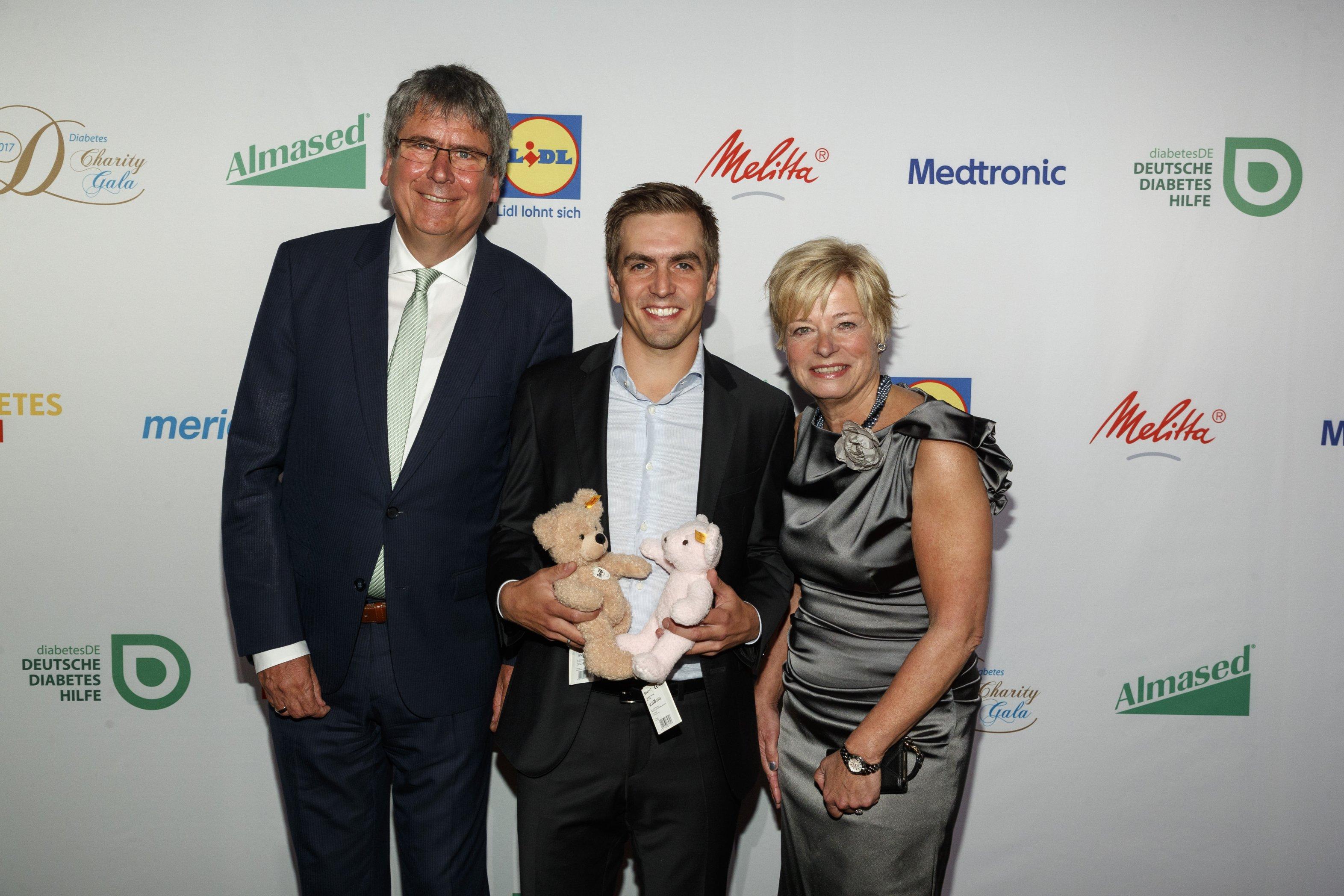 Dr. Jens Kröger, Philipp Lahm, Nicole Mattig-Fabian auf der Gala 2017